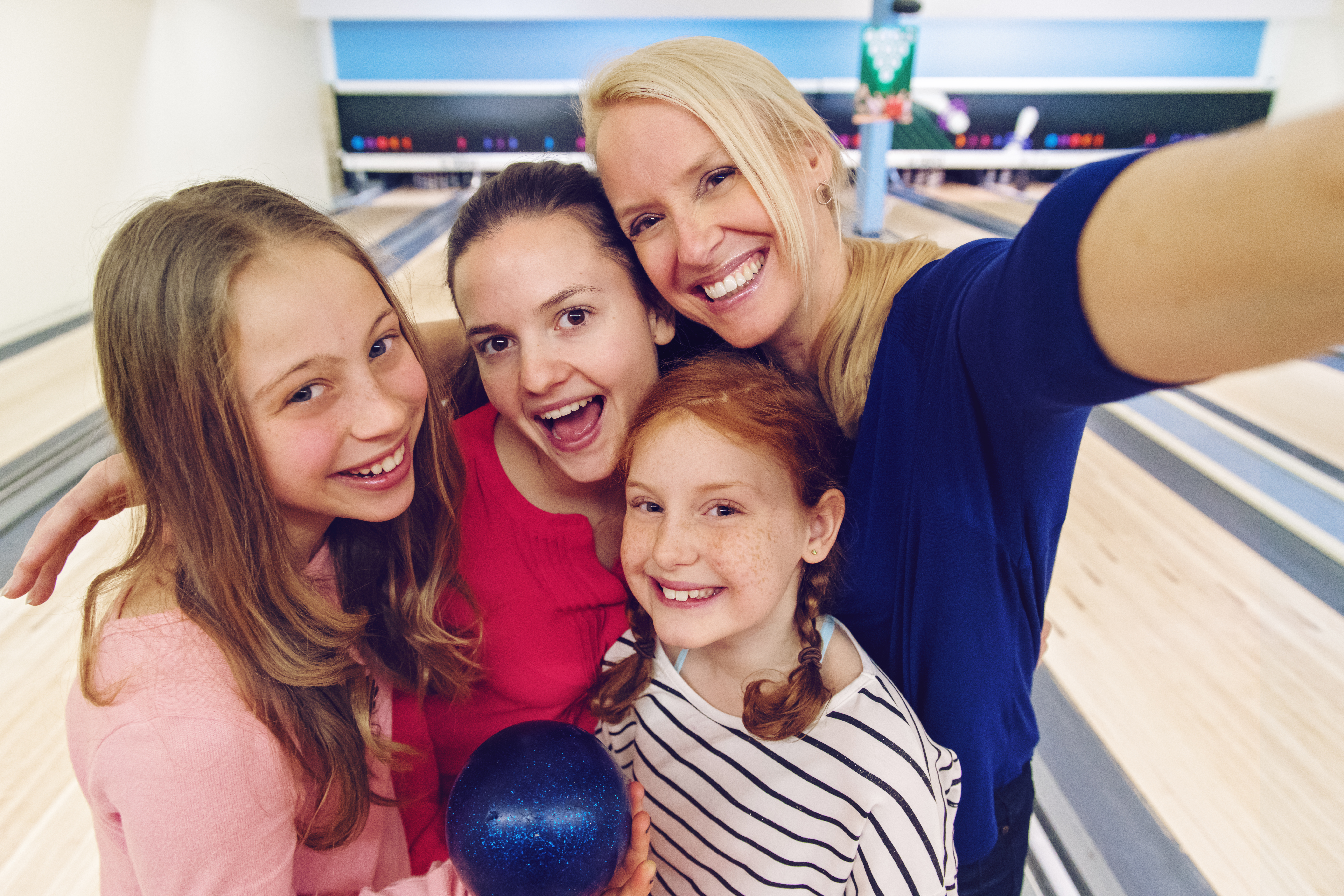 Girls at the bowling making selfies